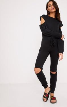 https://www.prettylittlething.com/lindsey-black-sweater-cold-shoulder-ripped-knee-jumpsuit.html